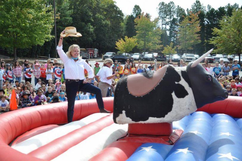 shallowford-falls-elementary-principals-ride-mechanical-bull-2.jpeg