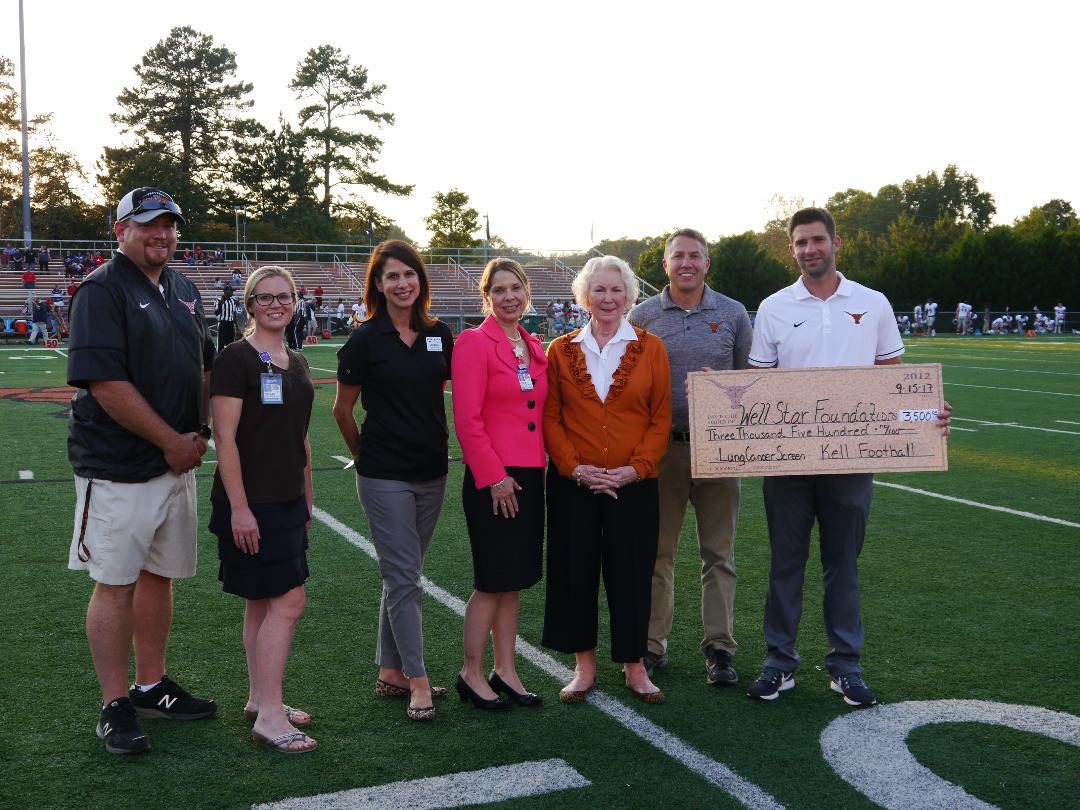 Kell High School Football Team Honors Legendary Coach With Donation To WellStar Foundation