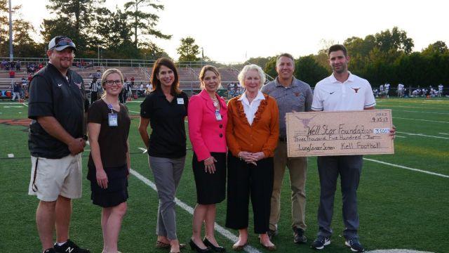 kell-high-school-football-team-honors-legendary-coach-with-donation-to-wellstar-foundation.jpg